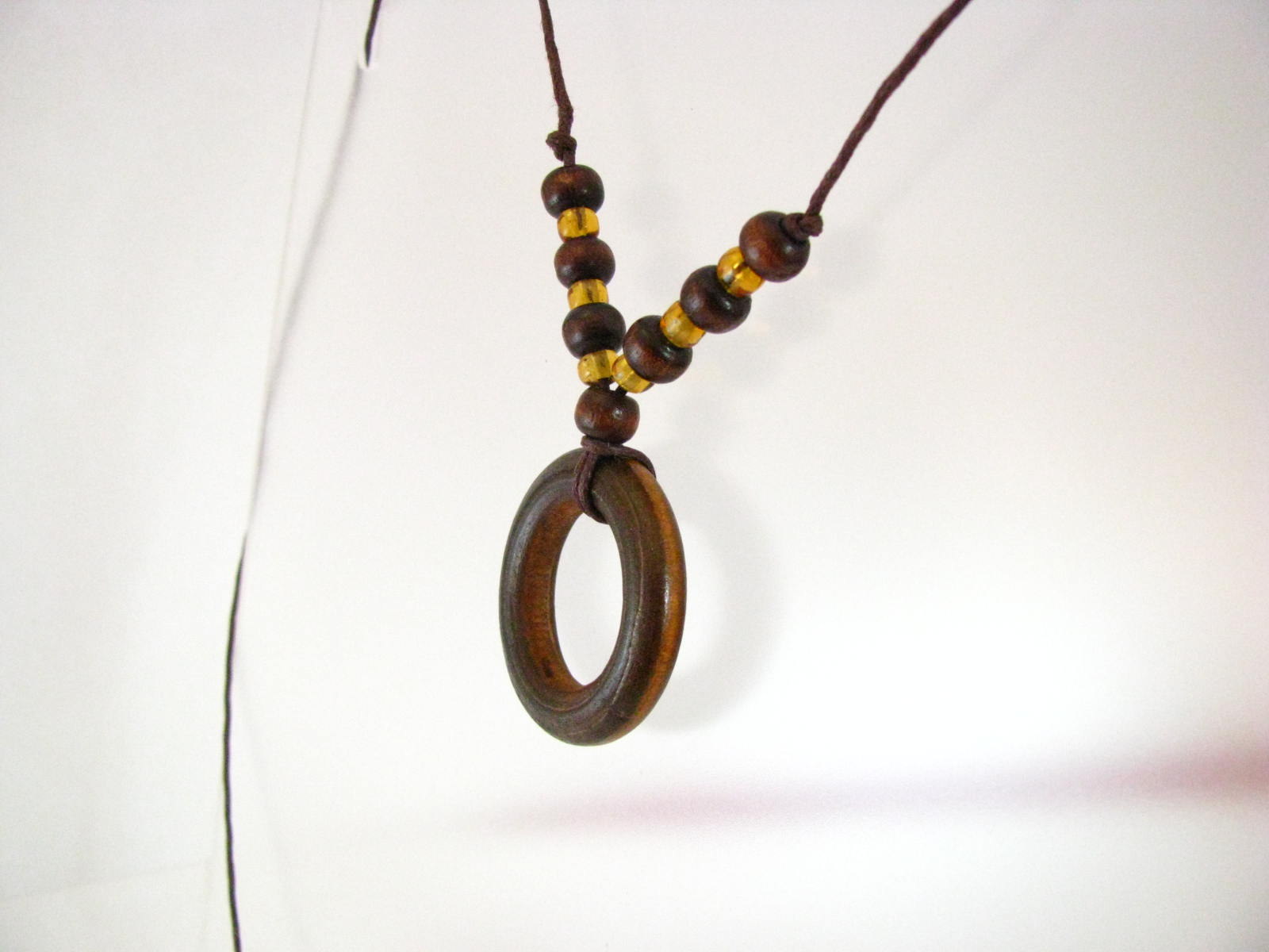 Wooden Circle with Amber Colored Glass Necklace